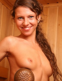 Teen in sauna exploses and rubs her bald pussy